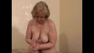 Gorgeous mature slut jerking young cock. Amateur older