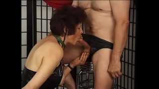 Mature chick in leather lingerie gives blowjob to old dude on her knees