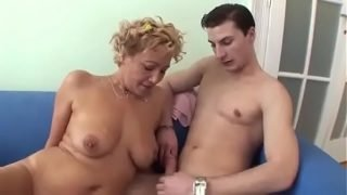 Mature Cougar Shows A Young Man How To Fuck