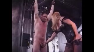 Two mature blondes in leather suits humiliate a tied young guy
